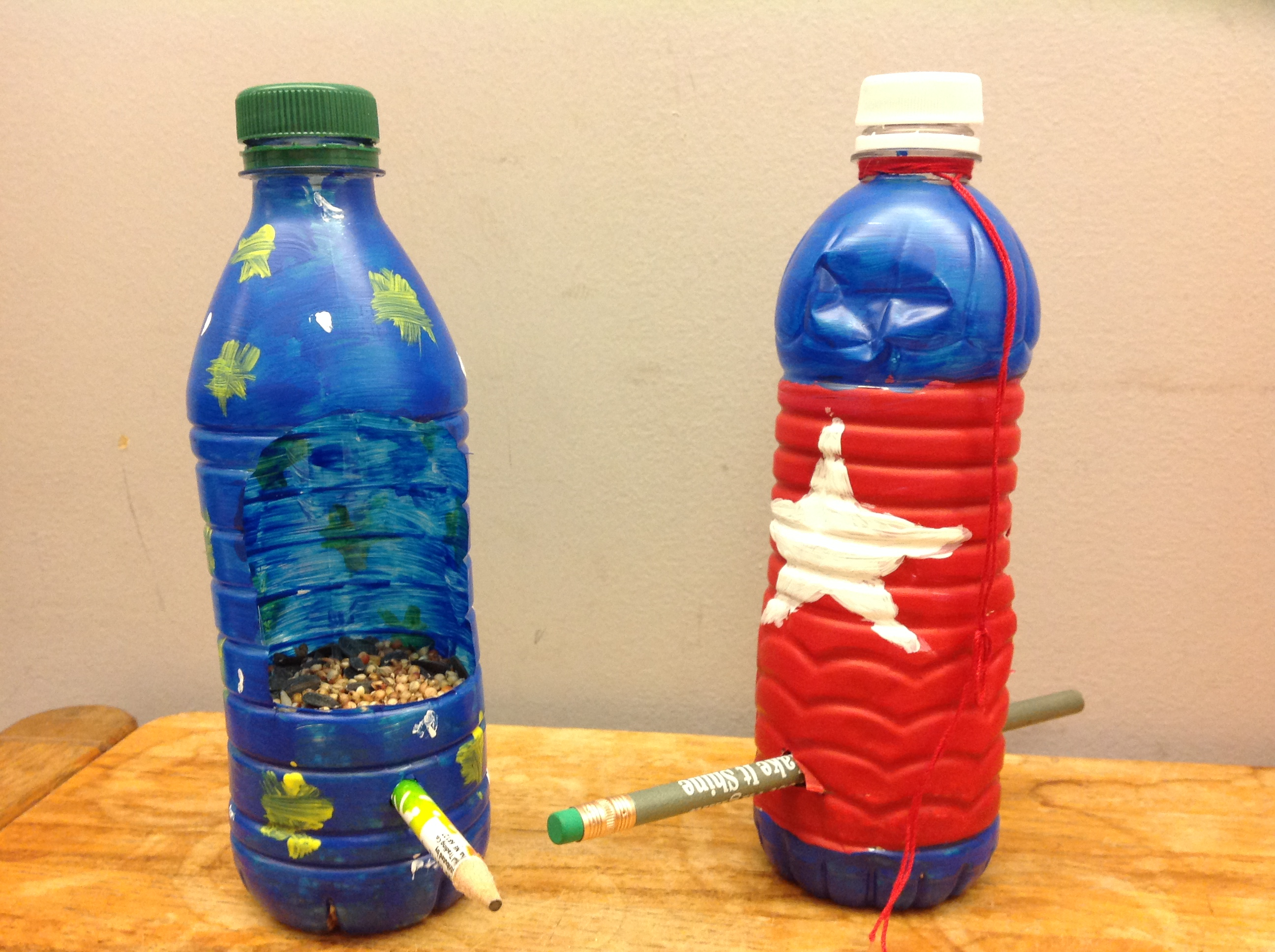 Water bottle bird feeders clay center ed ventures for How to make a bird feeder using a plastic bottle